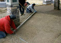 Can pavers be installed over concrete?